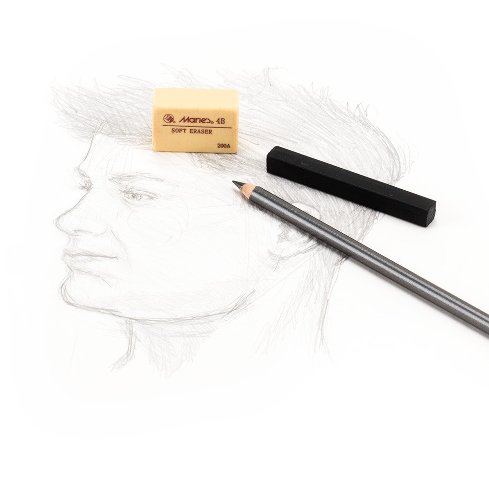 Removing charcoal, graphite and other artist less from paper or drawing boards
